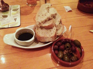 Fresh bread with balsamic dip and marinated olives