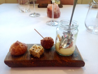 Truffle arancini, bacon, haddock and sweetcorn panna cotta, cheese and onion mousse and cheese gougere