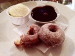 Doughnuts with salted chocolate caramel and vanilla ice cream