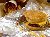 Five Guys' cheeseburger with mushrooms, ketchup and mustard and cajun fries