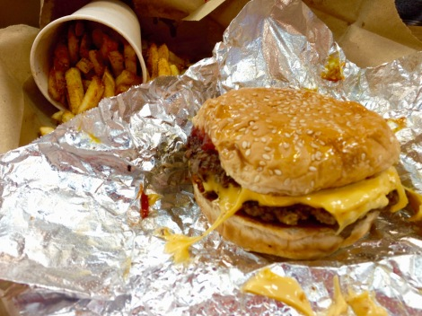 Five Guys' cheeseburger with mushrooms, ketchup and mustard and cajun fries