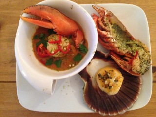 Lobster bisque with prawns, half garlic butter lobster and a lemon, lime and garlic hand-dived scallop