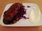 Venison steak with red cabbage and potato pancakes