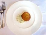 Hake and salmon fishcake, cauliflower and herb cous cous, lemon dressing