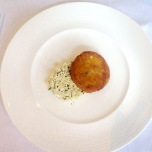 Hake and salmon fishcake, cauliflower and herb cous cous, lemon dressing