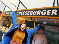 My friend getting very excited about eating real cheeseburgers